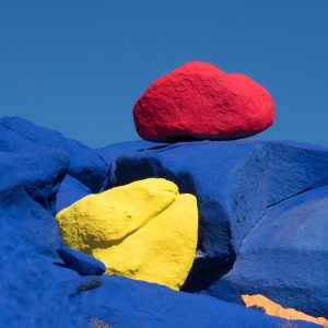 yellow and red stone on blue rocks